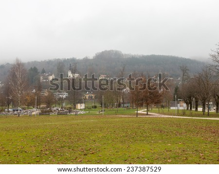 Mondsee - December 4, 2014 - the park for walking with a green lawn in the vicinity of Lake Mondsee December 4, 2014, Mondsee, Austria - stock photo