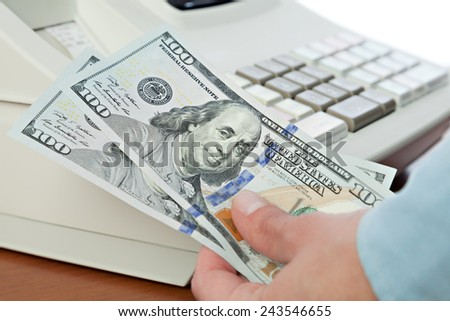 Money(a hundred dollar bills ) on the cash registers background - stock photo