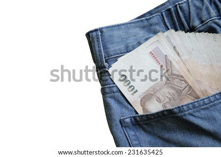 Money a jeans pocket, closeup isolated on white background