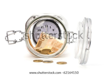 Money accumulation concept. Money and alarm clock isolated on white background. - stock photo