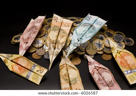 money airplane and coins - stock photo
