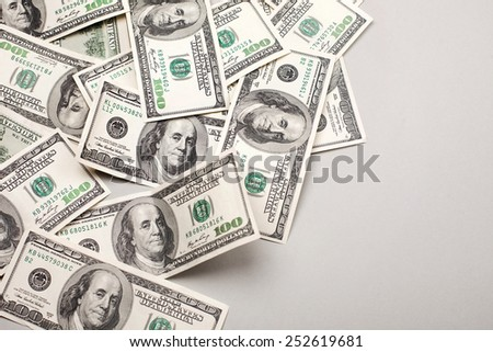 money american hundred dollar bills - horizontal on grey background - stock photo