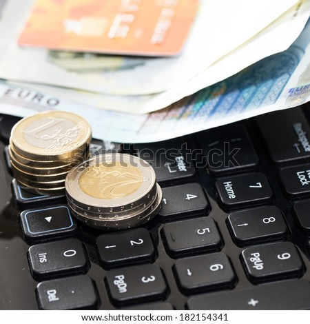 Money and bank card on the keyboard