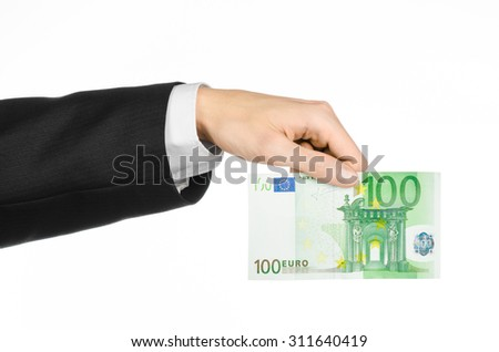 Money and business topic: hand in a black suit holding a banknote 100 euro isolated on a white background in studio
