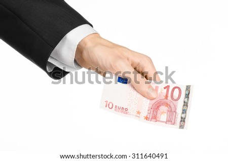 Money and business topic: hand in a black suit holding a banknote 10 euro isolated on a white background in studio
