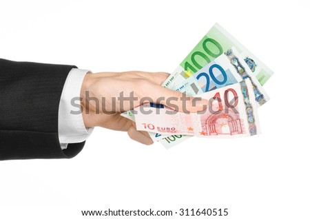Money and business topic: hand in a black suit holding banknotes 10,20 and 100 euro on white isolated background in studio