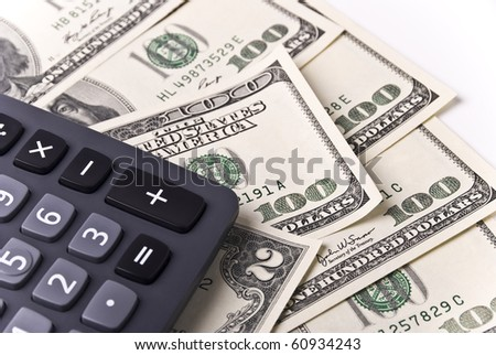 Money and calculator - stock photo