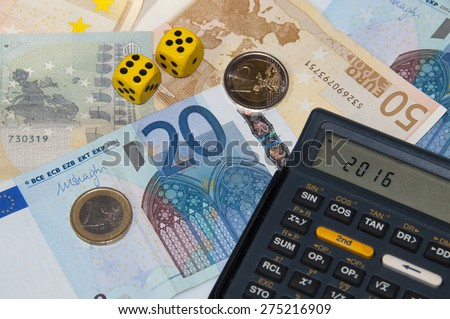 Money and calculator and dice  in year 2016 - stock photo
