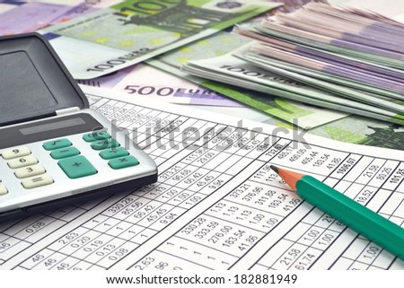 Money and calculator/ Image of calculator with money 100 and 500 euro - stock photo