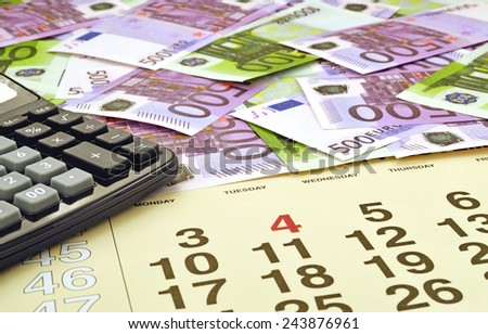 Money and calculator on  month calendar  - stock photo