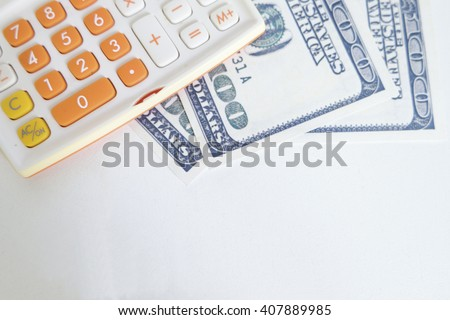 money and calculator on white desk , financial concept , business concept - stock photo