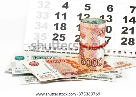 Money and calendar. Russia - stock photo