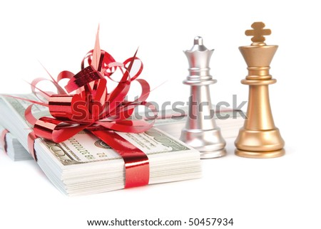 Money and chessmen on a white background - stock photo