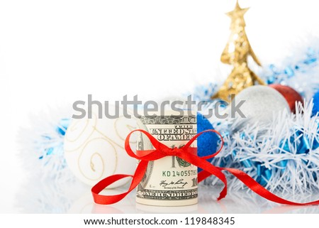Money and Christmas decorations on white background. - stock photo