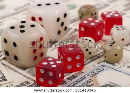 Money and dice - stock photo