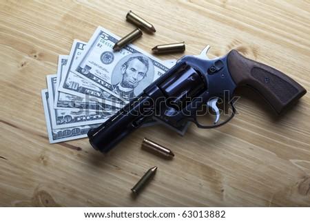 Money and gun - stock photo