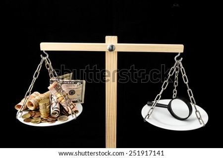 Money and Loupe on a Two Plan Balance Search Concept - stock photo