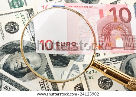 Money and magnifier. Exchange rate financial concept.