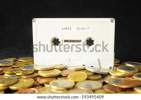 Money and Music Concept Tape Musicassette and Coins - stock photo