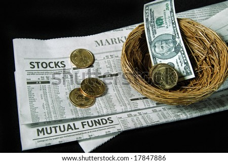 money and nest on stock report - stock photo