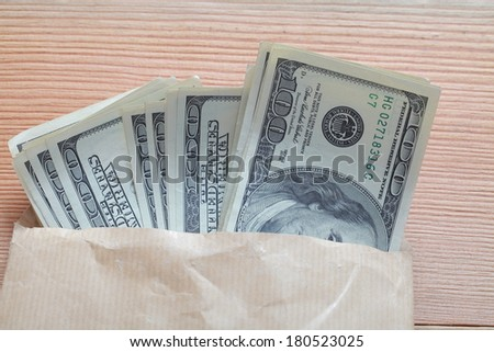 money and passport in an envelope - stock photo