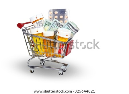 money and pill bottles in shopping cart isolated on white - stock photo