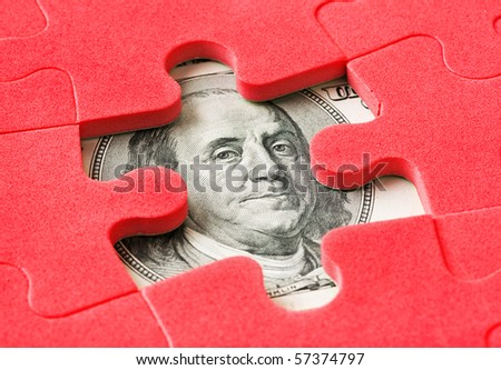 Money and puzzle - business concept - stock photo