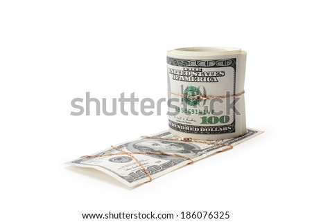 money and roll of money entwisted by gold on a white background isolated