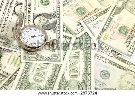 money and watch on it ... time concept - stock photo