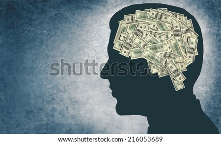 Money and your brain / outline of a man's head with the brain in the shape of money  - stock photo