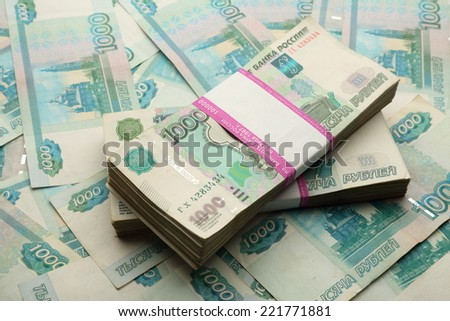 Money as background and in wrapper - stock photo