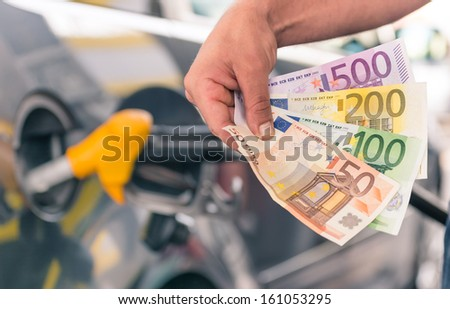 Money at gas station - stock photo