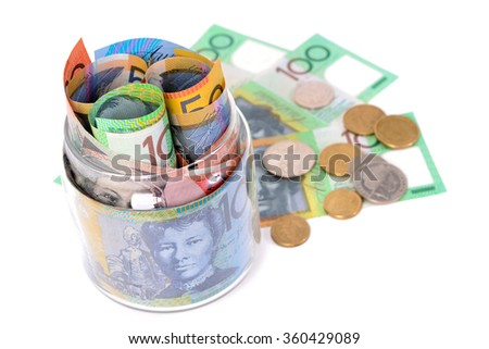 Money - Australian dollar banknotes and coins - stock photo