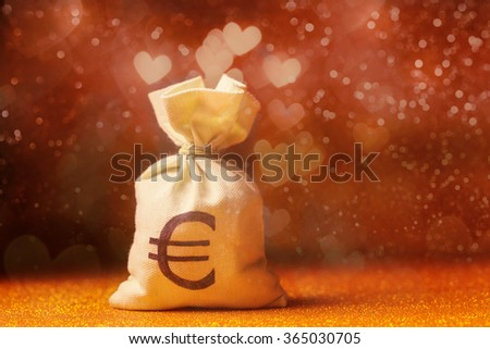 Money back over heart shaped defocused lights. Money and love concept - stock photo
