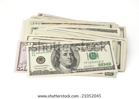 Money background. A pile of different dollars bills. The file includes clipping path.