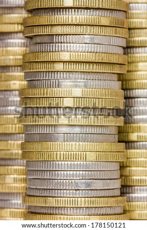 Money background. Close-up view of coins stacks
