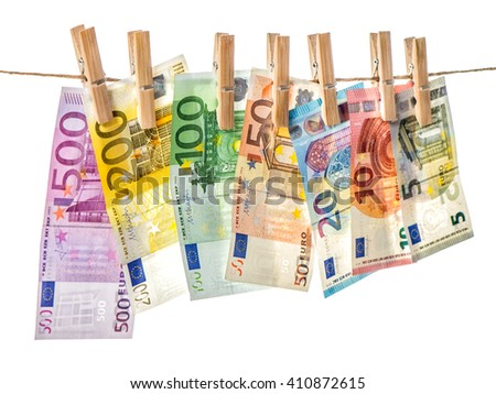 Money background. Euro banknotes hanging a rope with clothes pins. Selective focus - stock photo