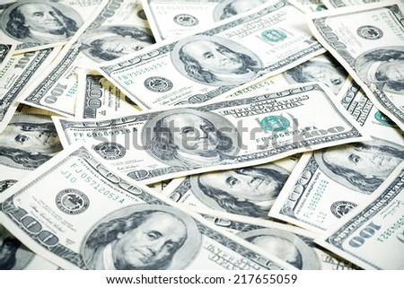 Money background of $100 bills in US currency with sharp focus in the center. - stock photo