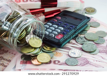 money background with coins and calculator for growing business - stock photo