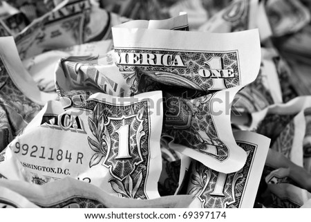 Money background with crumpled one dollar bills.  Black and white macro with shallow dof. - stock photo