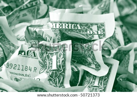 Money background with crumpled one dollar bills toned in green.  Macro with shallow dof. - stock photo