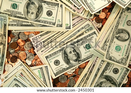 Money background with one hundred fifty and twenty dollar bills and coins - stock photo