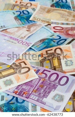Money Background with shallow depth of field: ten, twenty, fifty and five-hundred euro banknotes. - stock photo