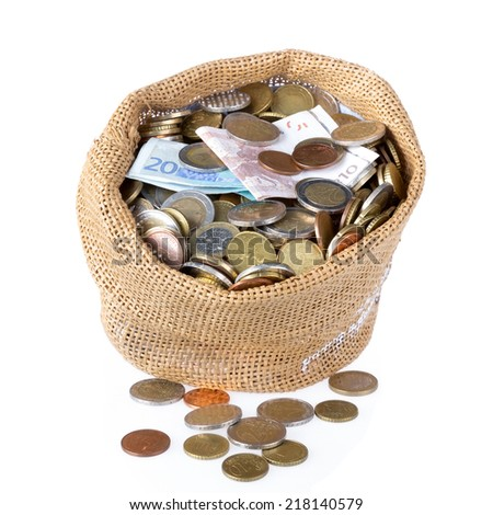 Money bag with coins and banknotes isolated at a white background - stock photo