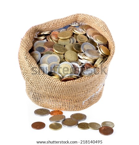 Money bag with coins isolated at a white background - stock photo