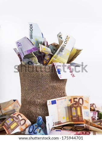 Money bag with euro notes and coins - stock photo