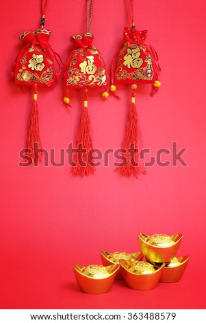 Money bags of the Chinese New Year on red Background. meaning prosperity and wealth  - stock photo