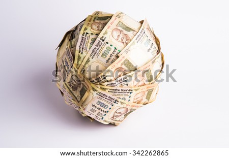 money ball using indian currency note, 500 or five hundred rupee notes, handmade, sphere, isolated on white background - stock photo