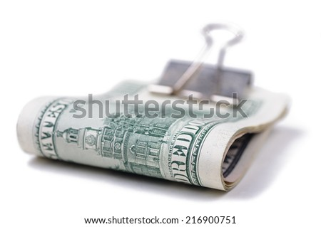 Money banknotes of hundred dollars in paper clip. Closeup with selective focus and shallow DOF. Isolated on white background. - stock photo