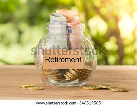 Money bottle and concept of  planning and savings for retirement. - stock photo